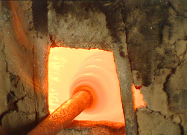 Glimmering Glass in Pine Wood Furnace